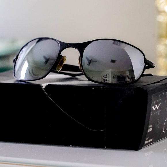 2990e568db OAKLEY Titanium Polarized Black Iridium Sunglasses.  M 5b32f51c9539f7b79f787682